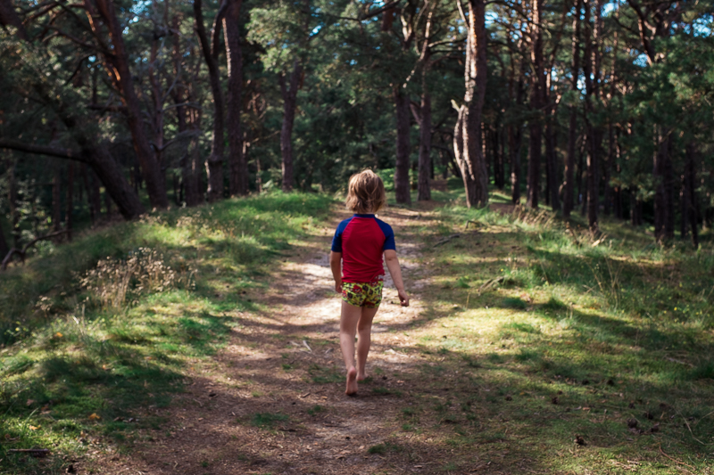 Child walking through the woods