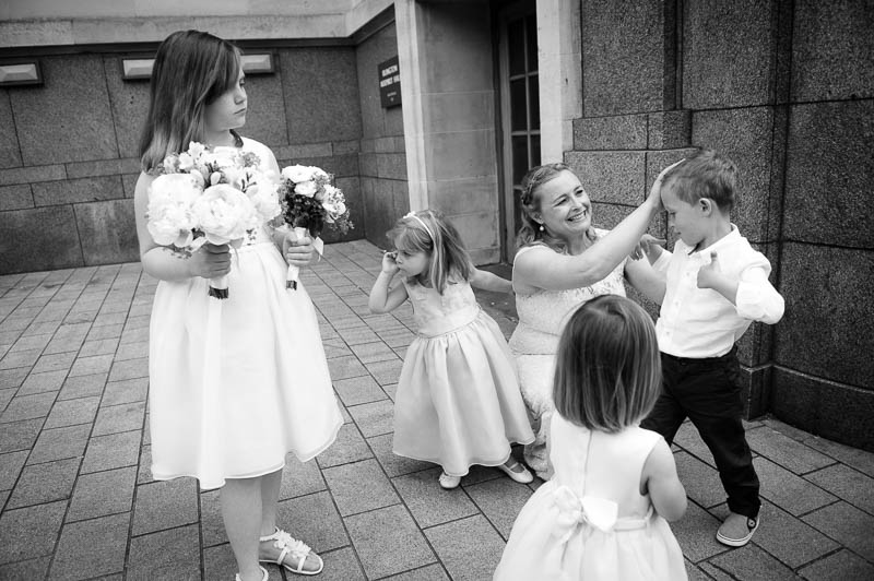 Bride helping children get ready for wedding at Islington Town Hall