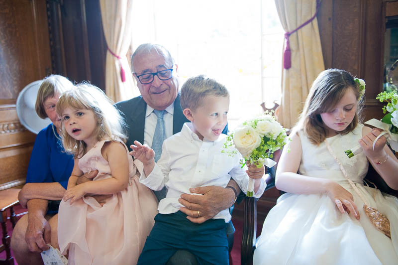 Grandfather with grandchildren at Islington town hall wedding