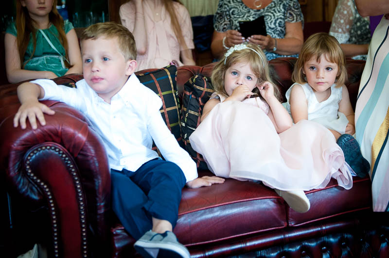 Candid wedding photograph of children during the ceremony at Islington Town Hall