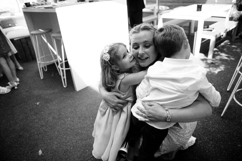 Bride hugging her children at Farringdon wedding