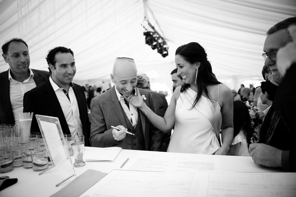 Signing the register at Jewish marquee wedding