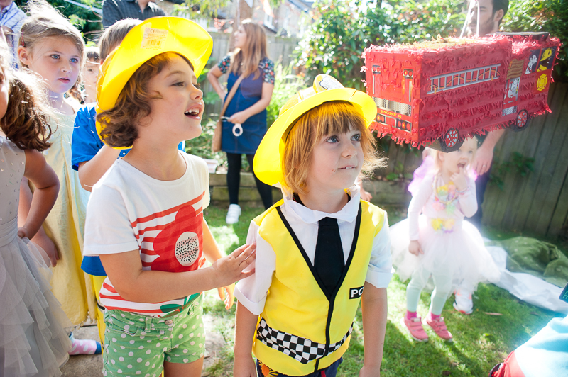 Boy and girl at emergency services kids birthday party