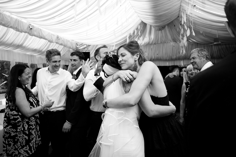 Bride hugging friend on the dancefloor