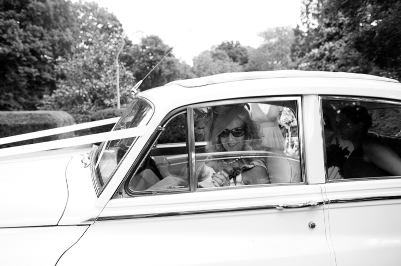 Documentary-style wedding photo of mother of the bride arriving at Ridge Farm