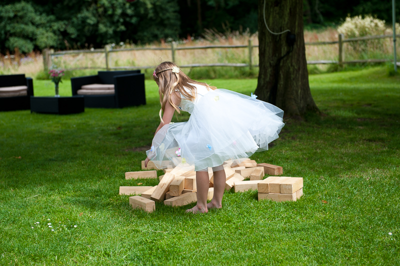 Flower girl playing Jenga at Ridge Farm wedding