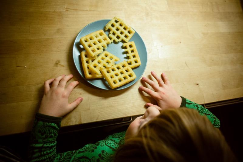 Boy eating potato waffle