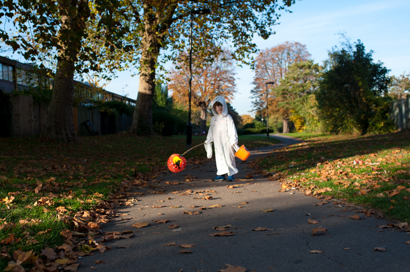Boy dressed as ghost on Halloween