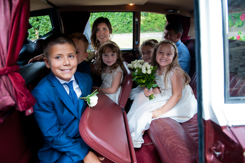 Children in the wedding party in vintage car