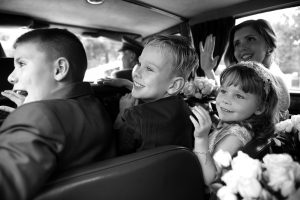 Bridesmaid and flower girls in wedding car