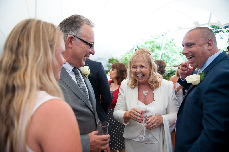 Bride and groom mingling with guests at Winchmore Hill wedding