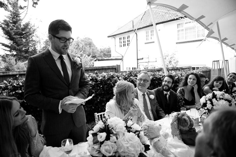 Son doing speech at mature wedding