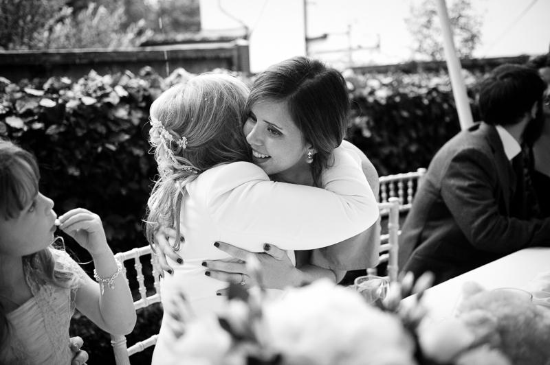Older bride hugging her daughter