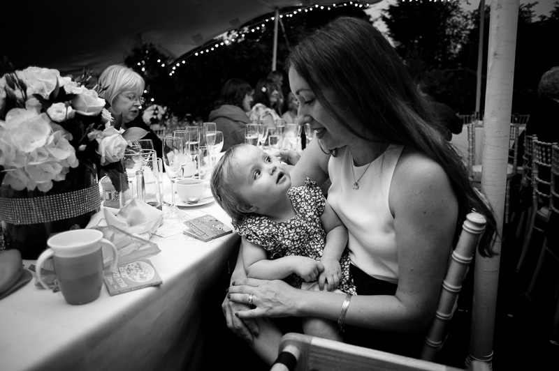 Wedding guest and baby at Winchmore Hill wedding