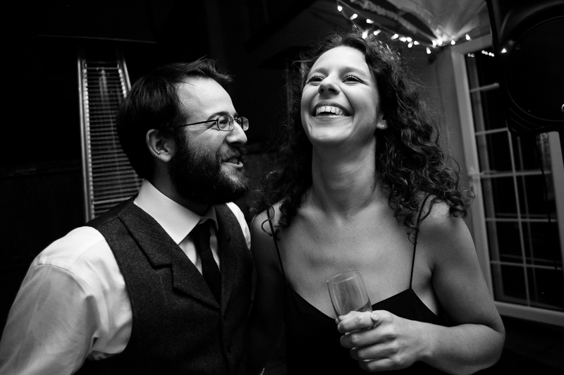 Black and white reportage photograph of guests on the dancefloor at Winchmore Hill wedding