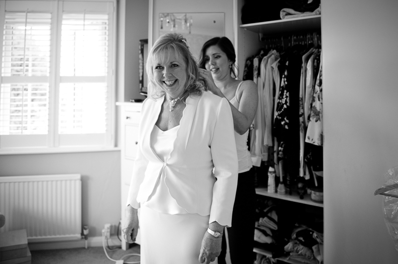 Mature bride and daughter getting ready