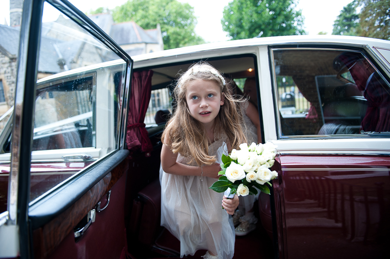Flower girl getting out of car at Enfield Registry Office