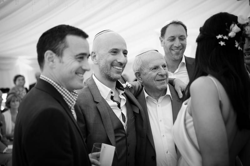 Groom with father in marquee wedding in Hertfordshire