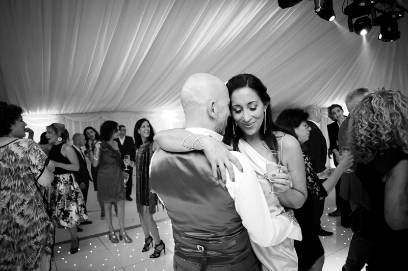 Black and white photograph of bride and groom dancing