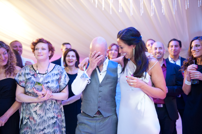 Bride and groom during the speeches at Jewish wedding in Hertfordshire