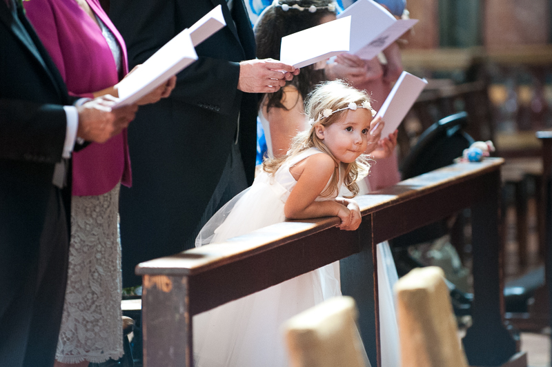 Flower girl watching ceremony at Brompton Oratory