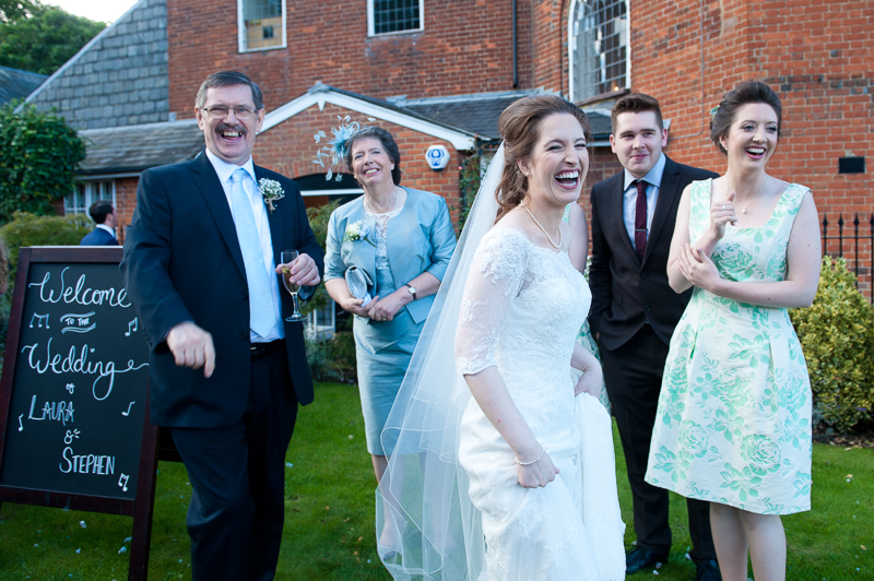 Bride and family laughing at Kings Chapel wedding