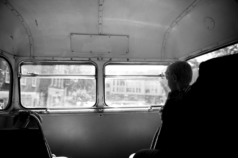 Boy on vintage London wedding bus