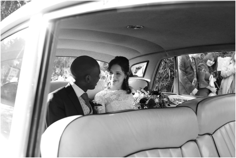 Bride and groom in Rolls Royce at Hatfield House wedding, Annelie Eddy Photography