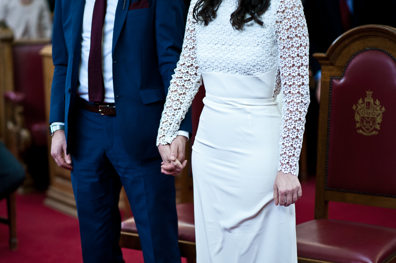 Bride and groom holding hands at Islington Town Hall wedding