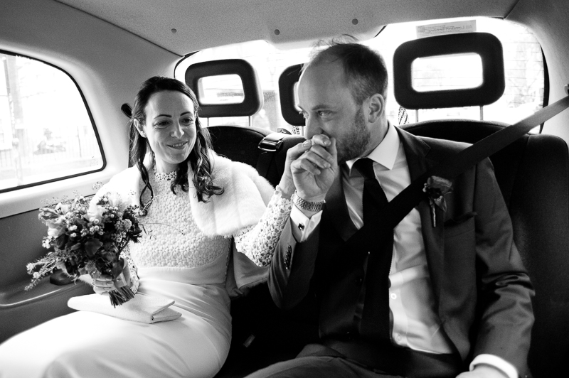 Bride and groom travel in taxi to West Reservoir Centre