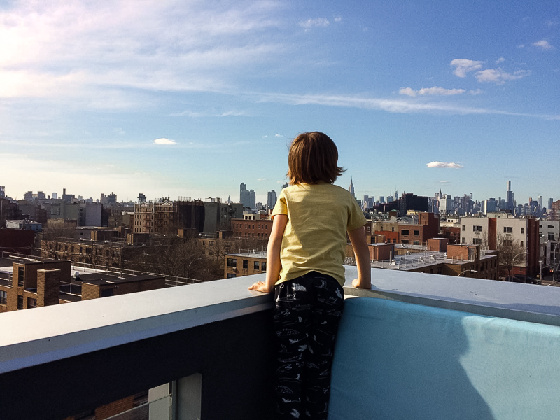 Boy on roof terrace in WIlliamsburg in Brooklyn