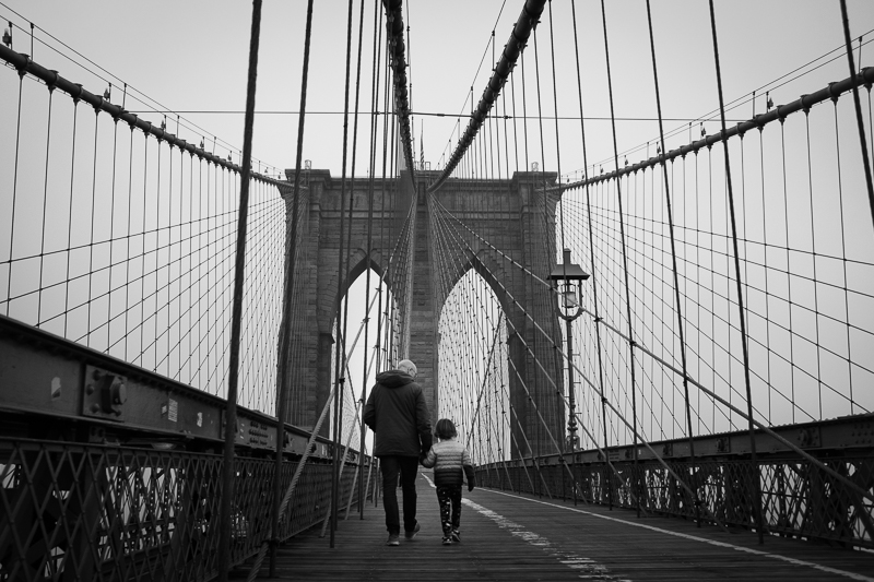 Father and son on Brooklyn Bridge