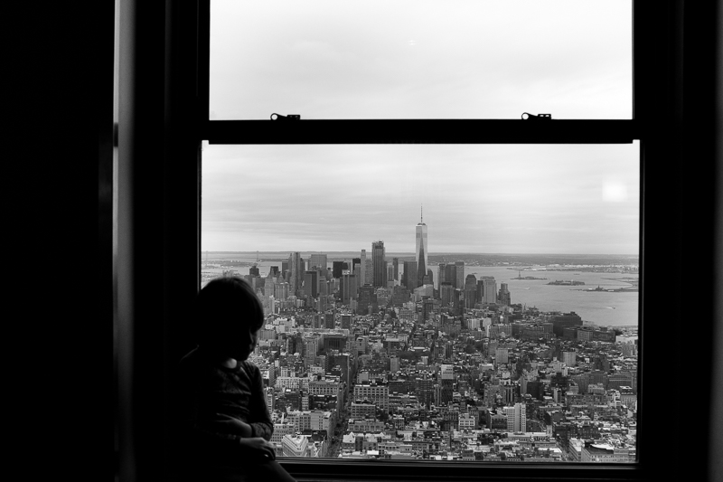 Boy looking out of Empire State Building