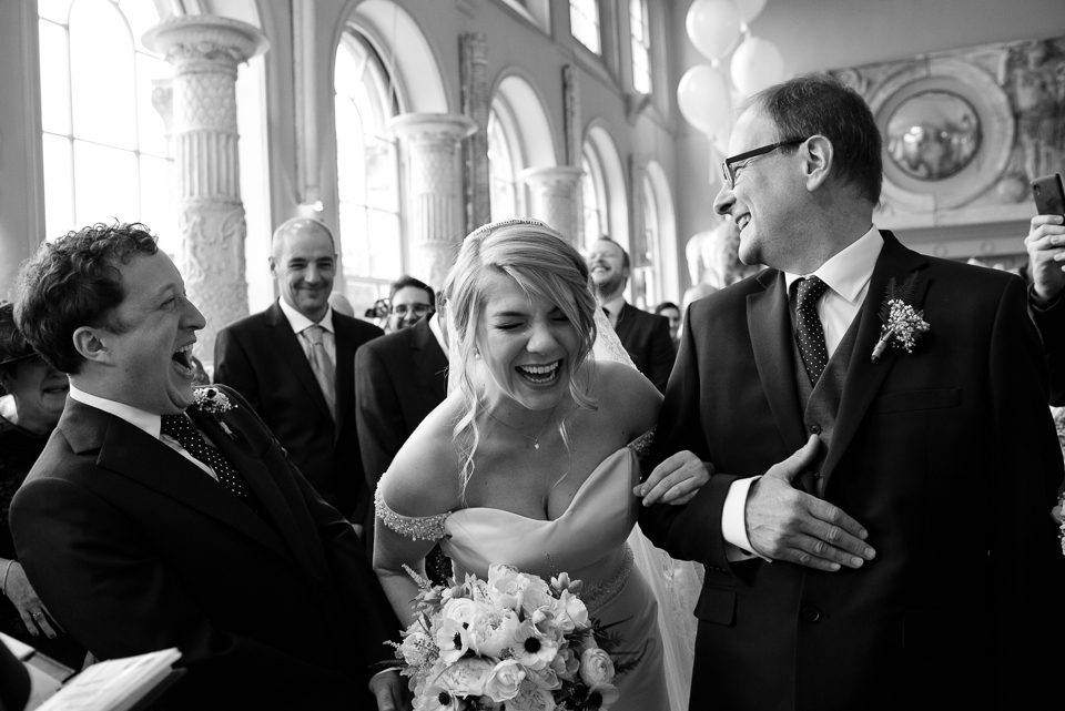 Bride and groom laughing at Aynhoe Park wedding