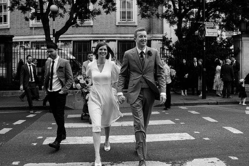 Bride and groom walk to Londesborough Pub