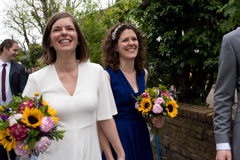 Bride and bridesmaid walking to Londesborough Pub wedding reception