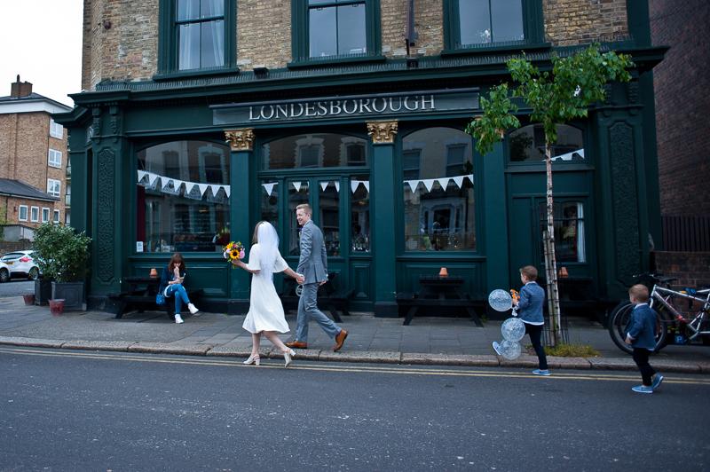 Bride and groom outside Londesborough Pub Stoke Newington