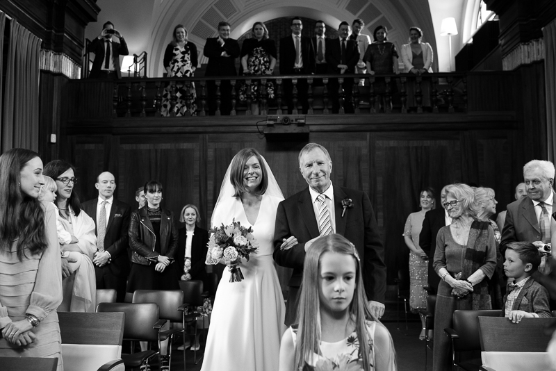 Bride walks down the aisle at Stoke Newington Town Hall