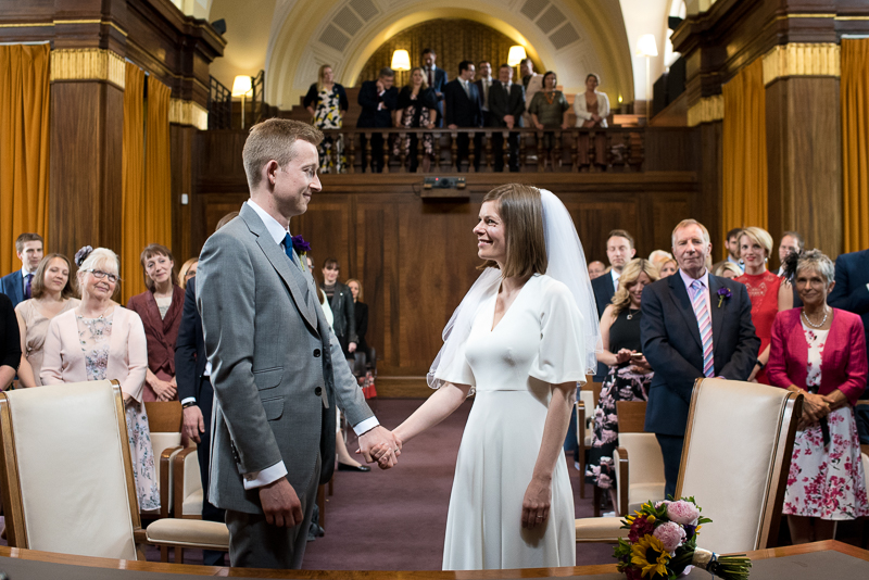 Bride and groom at wedding ceremony at Stoke Newington Town Hall