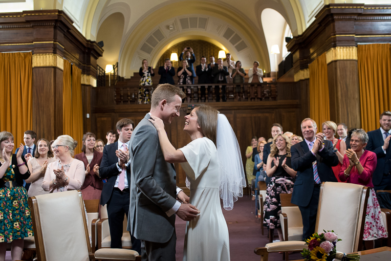 Bride and groom during Stoke Newington Town Hall wedding ceremony
