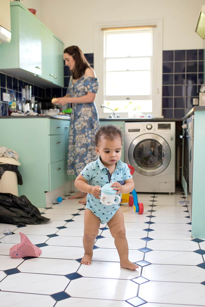 Baby toddling around kitchen during baby photography session in Palmers Green