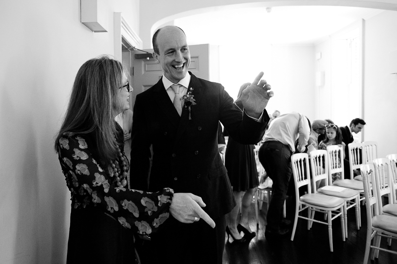 Groom greets guests at Clissold House