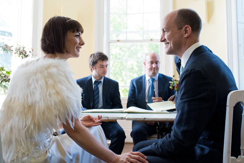 Bride and groom during wedding ceremony at Clissold House