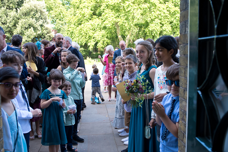 Guests waiting to throw confetti at Clissold House