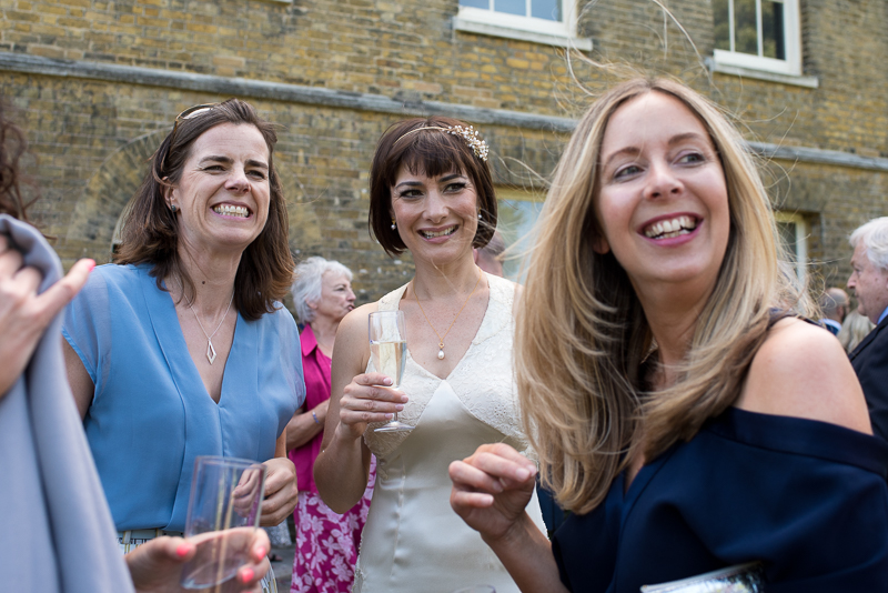 Guests mingling at Clissold House wedding