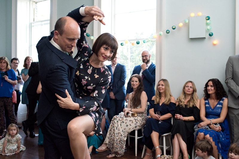 Couple performing tango for first wedding dance at Clissold House
