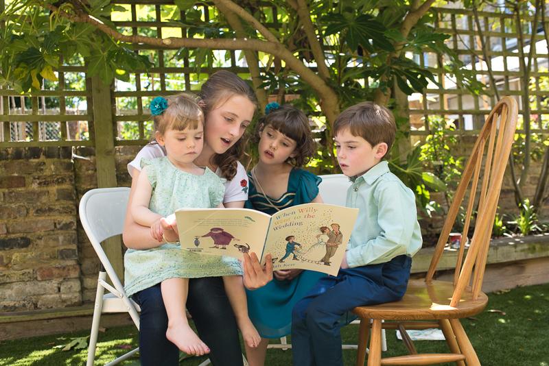 Kids reading wedding book before wedding