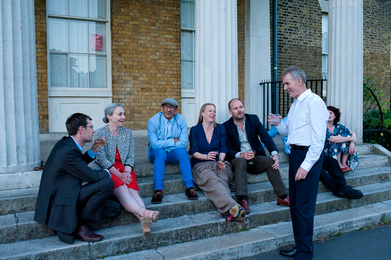 Guests on the stairs outside Clissold House