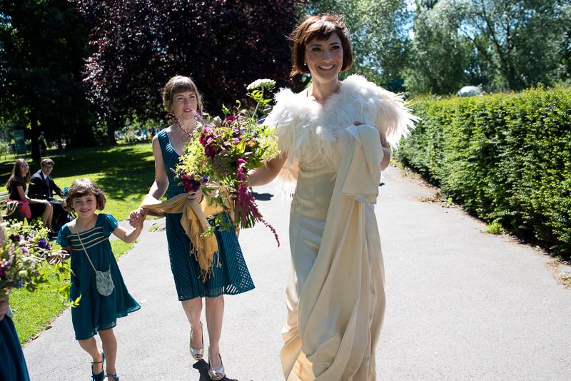 Bride walks through Clissold Park