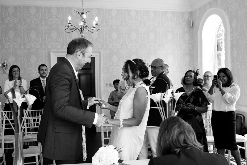 Bride and groom laughing at Merton Registry Office Wedding
